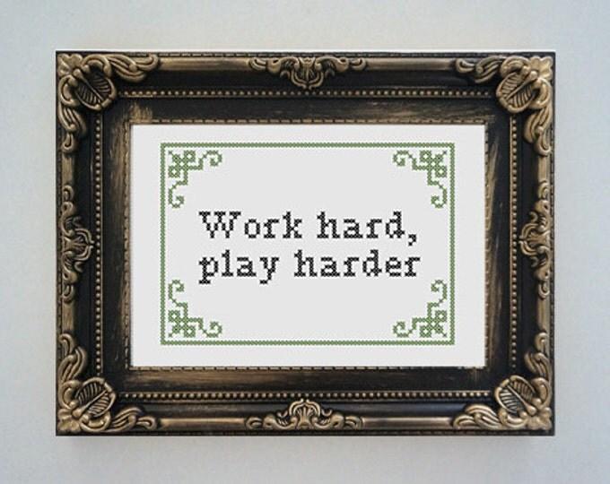 Framed 'Work hard, play harder' cross stitch
