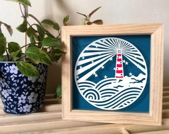 Handmade lighthouse paper cutting