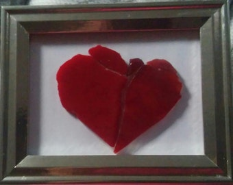 red stained glass shaped as a heart picture