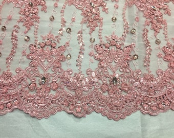 Pink magnificant design emrboider and heavy beaded on a mesh lace -yard