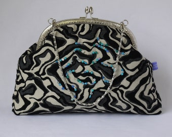 Beautiful grey and black beaded evening purse with snap frame