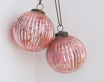 Two large salmon pink ribbed iridescent glass Christmas ornaments. Gorgeous!