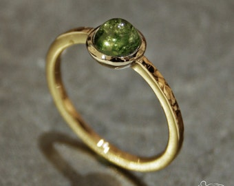 Yellow gold ring and white setting with tourmaline