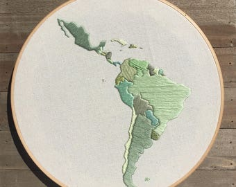 embroidered map of latin america