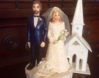 1983....the same year I was married so I dressed the bride up in lace! Vintage wedding cake topper!