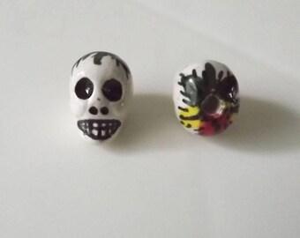35 pcs Rasta Skull Ceramic Beads.  14 mm. Drilled in the side.