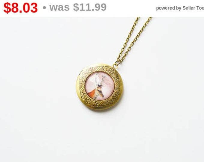 IN THE FOREST Round locket brass and glass with animal deer in retro and vintage style