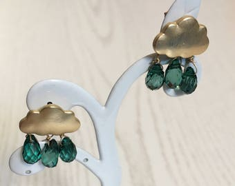 Ear plug clouds with green raindrops gold