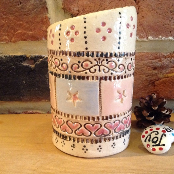 Handmade ceramic vase, patchwork feel, vintagey, richly patterned, stitchy detail