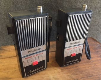 Two Realtone toy walkie talkies with Morse Code