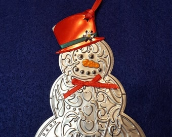 Snowman made from a recycled Coke can