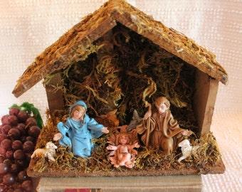 Vintage Nativity Scene in Moss Covered Wood Manger
