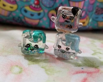 Custom Liquid filled glass ice cubes inspired by shopkins cool cube