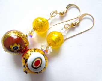 Gold Murano glass and Swarovski crystal beads with gold filled hooks.