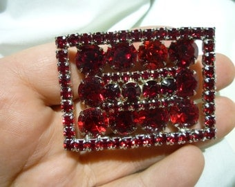A62 Vintage Kramer Marked Large Pin with Many Deep Red Stones.