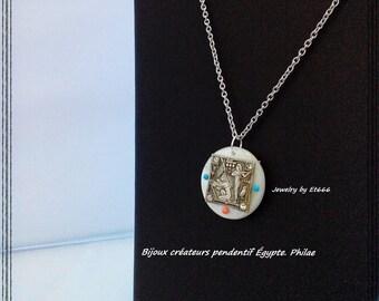 Jewelry creators Egyptian pendant double face. Philae