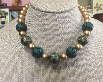 Turquoise and Gold Statement