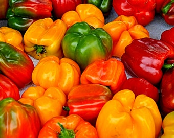 Bell peppers, yellow, green, red, sweet bell peppers at a farmers market