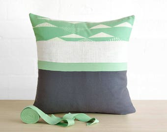 Throw pillow cushion cover in slate gray grey, pastel mint green and chalky white. Organic cotton print.