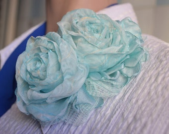 Brooch. Brooch with flowers. Brooch blue. The brooch on the dress. The brooch on the hat. Rose brooch.