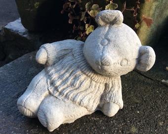 Cute stone teddy bear in jumper garden ornament