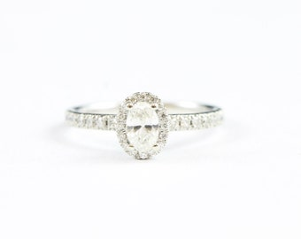 Oval diamond halo engagement ring in 18 carat white gold for her