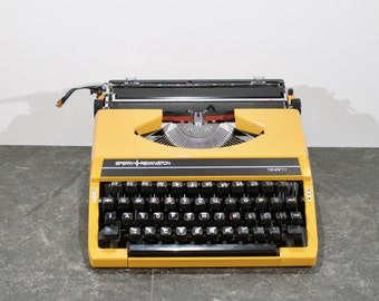 Vintage yellow Sperry-Remington Tenfifty typewriter