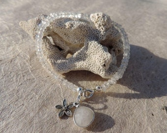 faceted moonstone beaded bracelet with silver bezel set faceted moonstone charm and silver plated flower charm
