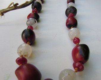 Red and Black Huahuro Beads from Peru and Black Tahuas