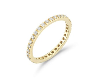 Eternity Band Ring with White Diamonds all around, French-set, 18k Yellow Gold.