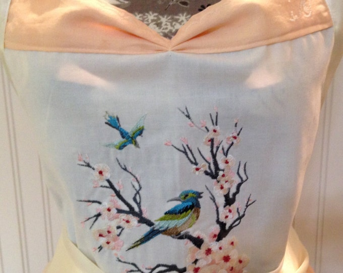 Featured listing image: Vintage tablecloth full apron - embroidered bodice - cherry blossom - blue bird - embroidered napkin - Battenberg lace