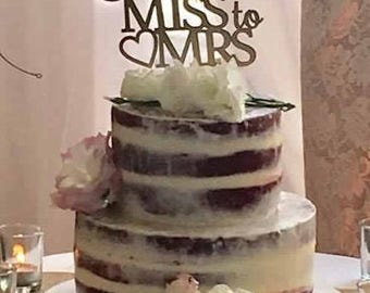 Bridal Shower/Kitchen tea cake topper reads: From Miss to Mrs