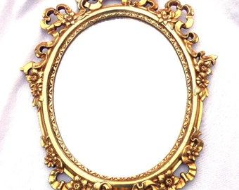 Baroque mirror in deep gold vintage oval frame vintage ornate for Plastic baroque mirror