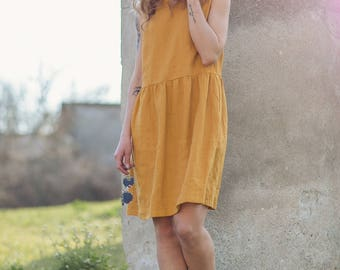 Washed and soft linen dress. Sleeveless linen dress. Relaxed fit soft linen dress with pockets.