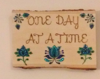 Wood burned plaque or sign with quote One Day At A Time painted and embellished with colored crystals