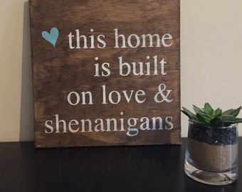 This home is  built on love and shenanigans sign, housewarming gift, home decor, hand painted wall art sign