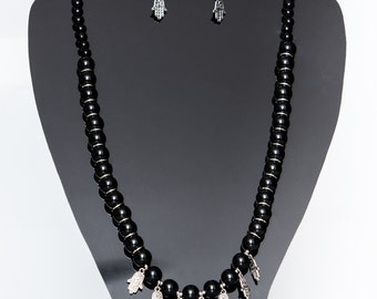 Black beaded necklace with charms.