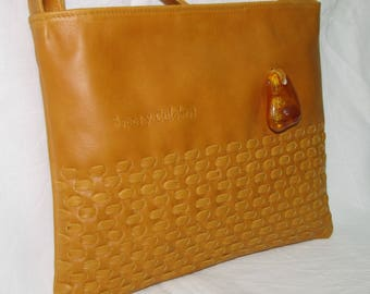 Fur handbag quilted by hand with adornment of the Baltic amber.