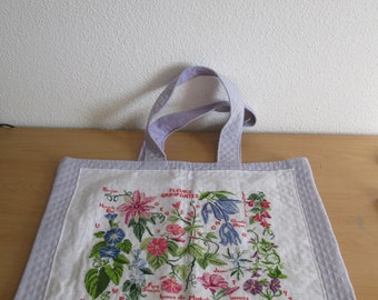 Bag handbag or purple beach bag hand-embroidered with different flowers