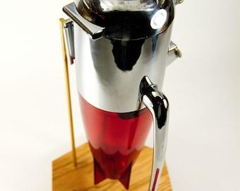 Dazey Ice Crusher on custom museum mount atomic age space rocket mid century modern design kitchen bar chrome fins