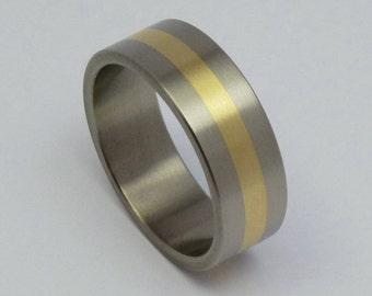Titanium and 14 carat gold ring, weddingring.
