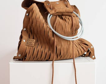 All leather handbag, great for the beach, excellent for shopping and stylish for a night on the town.