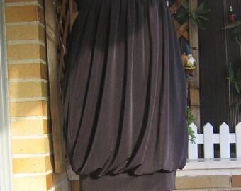 Dress knitted black, designed globe. Short black globe type dress. Black dress tied around the neck