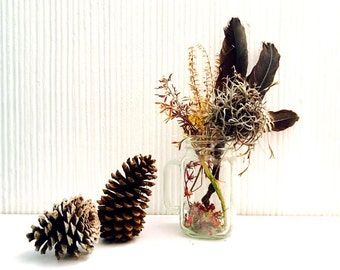 Floral arrangement with eagle feathers