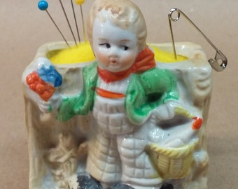 Vintage Little Boy carrying Basket Planter remade into Pin Cushion
