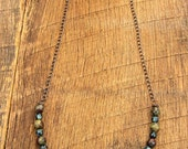 RESERVED for Loretta Hammered Double Circle Necklace with Dragon Blood Jasper and Czech Glass Beads antique copper black green red