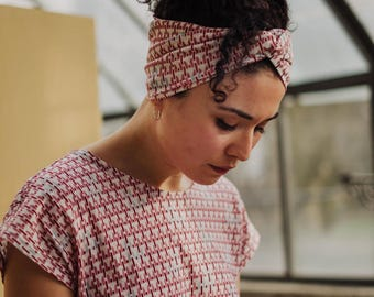 Patterned white pink and light blue turban headband in soft viscose jersey with a twist