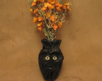"Grichels small flower vase - ""Nilego"" 29172 - black leather with green and brown slit pupil alligator eyes"