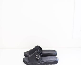 Timberland black leather buckle strap sandals - women's size 7