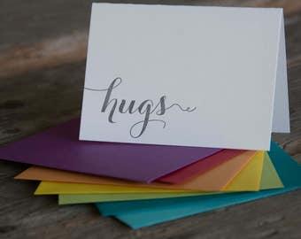 hugs letterpress cards, in purple or black letterpress printed card. Eco friendly